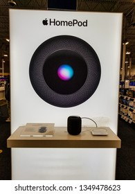 ELK GROVE, CA/U.S.A. - MARCH 23, 2019: A photo of an Apple HomePod display promoting the company's smart speaker that adapts to its location and delivers high-fidelity audio.