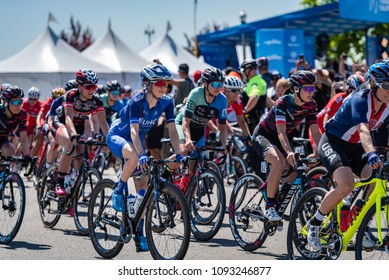 ELK GROVE, CA/U.S.A. - MAY 17, 2018: Katie Hall of the United Healthcare team smiles as the women's peloton begins the start of Stage 1 of the annual Amgen Tour of California cycling race.