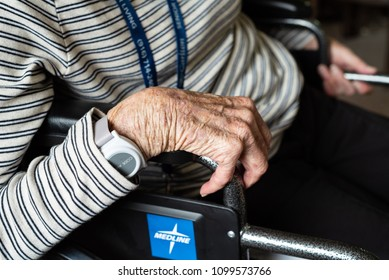 ELK GROVE, CA/U.S.A. - MAY 25, 2018: A photo of Parkinson's patient Cynthia Allan's claw-like hand gripping the handle of her wheelchair.