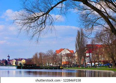 Elk, Masuria / Poland - 2010/03/27: Panoramic view of the town of Elk with a historic water-tower at the Elckie lake