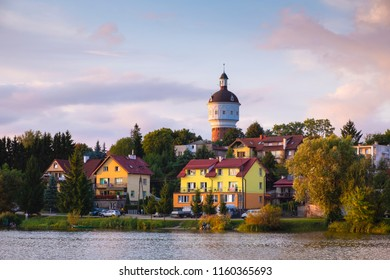 Elk, Masuria region / Poland - 2018/08/15: Panoramic view of the town of Elk with a historic water-tower at the Elckie lake