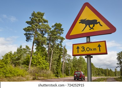 Elk moose traffic road signal on a finnish landscape. Finland