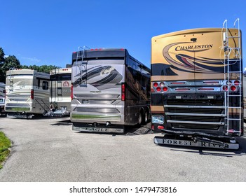 ELKHART, INDIANA - AUGUST 9, 2019: Several new large Class A rv motorhomes are parked together in a line
