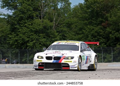 Elkhart Lake Wisconsin, USA - August 18, 2012: Road America Road Race Showcase, ALMS, multi-class sports car and GT motor race. American Le Mans Series. IMSA Jorg Muller, Bill Auberlen, BMW M3