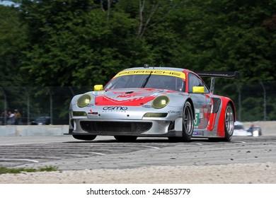 Elkhart Lake Wisconsin, USA - August 18, 2012: Road America Road Race Showcase, ALMS / IMSA multi-class GT motor race. American Le Mans Series. Jorg Bergmeister, Patrick Long, Porsche 997 GT3-RSR