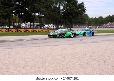 Elkhart Lake Wisconsin, USA - August 18, 2012: Road America Road Race Showcase, ALMS / IMSA GT class. American Le Mans Series Four-hour, timed period. Ed Brown, Guy Cosmo, Anthony Lazzaro Ferrari