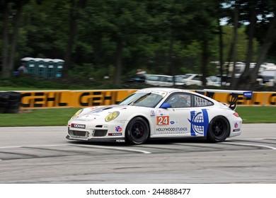Elkhart Lake Wisconsin, USA - August 18, 2012: Road America Road Race Showcase, ALMS, sports car and GT IMSA. American Le Mans Series Four-hour race. Bob Faieta, Michael Avenatti, Porsche GT3
