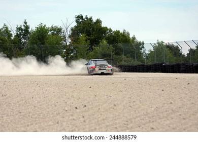 Elkhart Lake Wisconsin, USA - August 18, 2012: Road America Road Race Showcase, ALMS / IMSA sports car GT class. American Le Mans Series Four-hour, timed period. Angel Benitez Sr., Angel Benitez Jr.