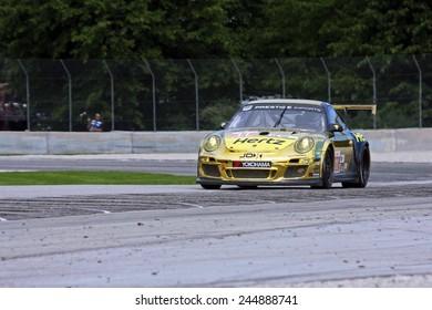 Elkhart Lake Wisconsin, USA - August 18, 2012: Road America Road Race Showcase, ALMS, multi-class sports car GT motor race. American Le Mans Series. Tim Pappas, Jeroen Bleekemolen, JDX Racing IMSA