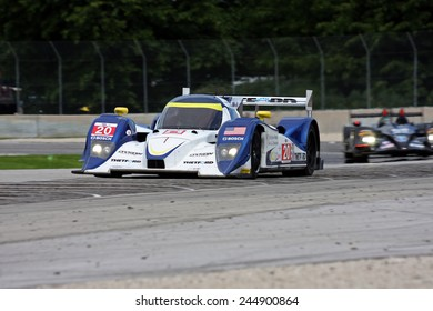 Elkhart Lake Wisconsin, USA - August 18, 2012: Road America Road Race, ALMS / IMSA prototype sports car motor race. American Le Mans Series. Michael Marsal, Eric Lux Canada, Tony Burgess, Lola B11/66