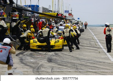 Elkhart Lake, Wisconsin USA - August 9, 2015: Road America road course, IMSA - Corvette racing team cars make tire and fuel pit stop. Corvette C7.R IMSA Tudor GT Le Mans class.