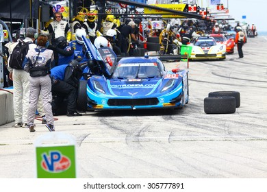 Elkhart Lake, Wisconsin USA - August 9, 2015: Road America road course, IMSA. The blue Chevrolet Corvette DP of VisitFlorida.com Racing makes a pit stop for fuel and tires.