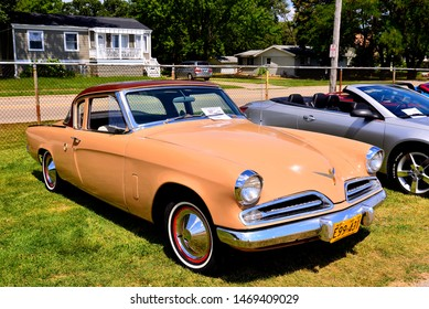 Elkhorn, Wisconsin / USA - August 3, 2019: A beautiful restored 1953 two tone Studebaker Commander with image taken at three quarter view to show front and passenger side.