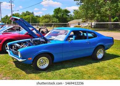 Elkhorn, Wisconsin / USA - August 3, 2019: A beautifully restored customizes and enhanced 1970 Ford Maverick with gorgeous blue paint and aftermarket wheels at the local car show.