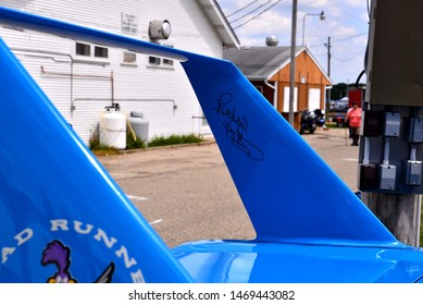 Elkhorn, Wisconsin / USA - August 3, 2019:  A bright Petty blue Dodge Superbird from 1970 on display at the local car show.  The wing is signed by Richard Petty on the drivers side of the wing.
