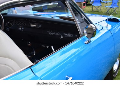 Elkhorn, Wisconsin / USA - August 3, 2019: The dashboard in this 1970 Plymouth Road Runner Superbird is autographed from Richard Petty.  The exterior of the car color is Richard Petty Blue.