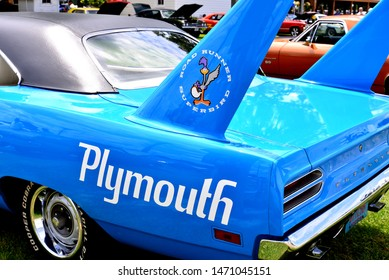 Elkhorn, Wisconsin / USA - August 3, 2019: The beautiful muscle car logos on this 1970 Plymouth Road Runner Superbird in Petty blue.
