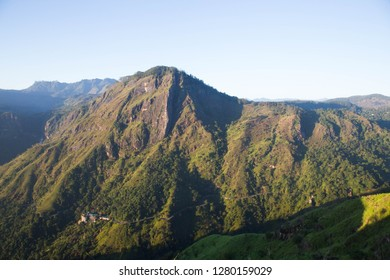 Ella rock at Little Adam's Peak, Ella. Green mountain range in morning light with sky