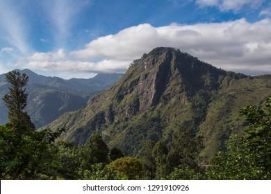 Ella rock is a popular hiking destination in Ella, Sri Lanka. Sunny day, deep blue sky with clouds