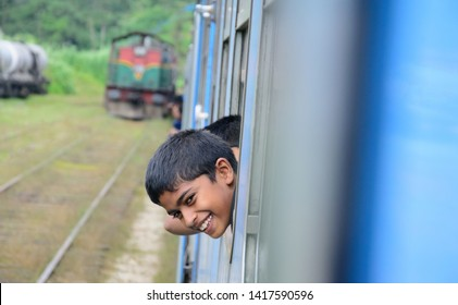 ELLA, SRI LANKA – JUNE 03: Passengers are enjoying the train journey from Kandy to Ella on June 03 2019 in Ella, Sri Lanka. The train winds through the mountains overlooking villages & tea plantations