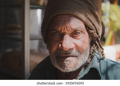 Ella, Sri Lanka - March 23 2019: Close-up street portrait of a local Sri Lankan man in the village of Ella, Sri Lanka.
