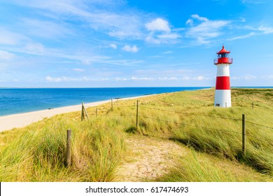 Ellenbogen lighthouse on sand dune and beach view on northern coast of Sylt island, Germany