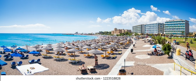 Elli beach with sunshades, sun beds and hotels in city of Rhodes, Panorama (Rhodes, Greece)