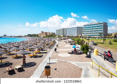 Elli beach with sunshades, sun beds and hotels in city of Rhodes (Rhodes, Greece)