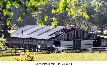 ELLICOTT CITY, MARYLAND - May 31, 2019: Aftermath of storm damage showing barn roof partially ripped away