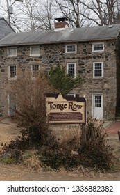 Ellicott City, MD - March 9, 2019: This sign explains the history of Tonge Row, a group of rowhouses from the early 1800s.