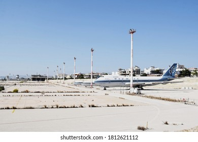 Ellinikon / Greece - September 2020: Abandoned International Airport of Ellinikon (or Hellinikon) with several old aircrafts. View of abandoned airstrip, airport control tower, buildings and airplanes