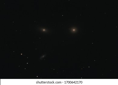 The elliptical galaxy Messier 105, the lenticular galaxy NGC 3384, and the spiral galaxy NGC 3389 in the constellation Leo photographed with a Maksutov telescope from Mannheim in Germany.
