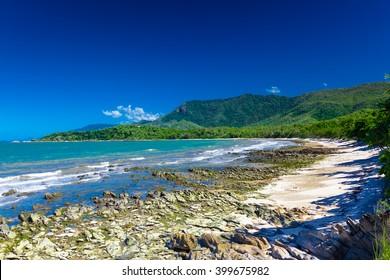 Ellis Beach with rocks near Palm Cove and Cairns, Australia