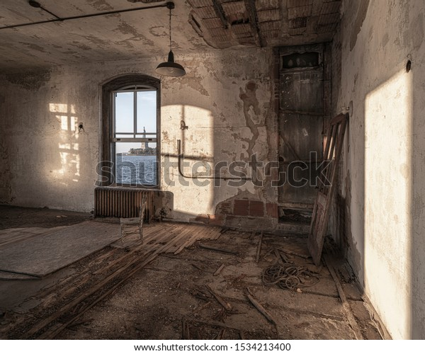 Ellis Island abandoned hospital interior witha view to the Statue of Liberty.