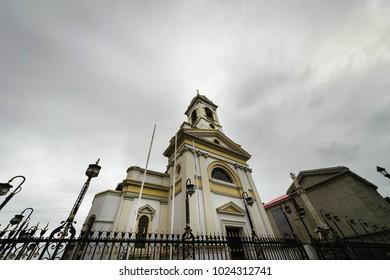ellow church with bells and clock in Punta Arenas, Chile
