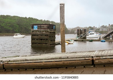 Ellsworth, Maine, USA - September 19, 2018: Late summer at Ellsworth Harbor Park & Marina. The massive boxes built from railroad ties and stones anchor the docks through years of rough weather.