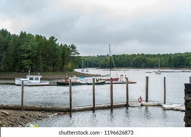 Ellsworth, Maine, USA - September 19, 2018: Docked boats at Ellsworth Harbor Park & Marina on the Union River on late summer afternoon