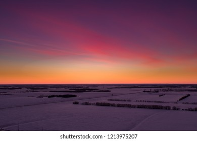 ELM CREEK, MB - Jan 1, 2018 An aerial view of the sunset over farmer's fields