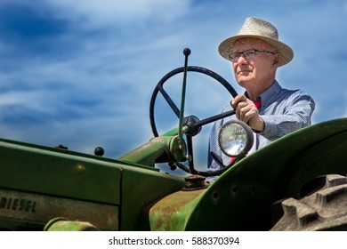 ELM CREEK, MB - JULY 1, 2016 A local farmer participates in an old time threshing demonstration as part of Canada Day festivities