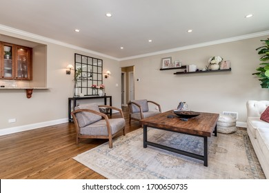 ELMHURST, IL, USA - MARCH 15, 2020: A large living room filled with chairs, couch and wooden coffee table.