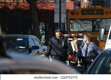 Elmhurst, NY / United States - November 8 2018: NYPD responds to a student stabbing at the Corona Civic Leadership Academy high school. Sergeant in the School Safety Division with responding officer.