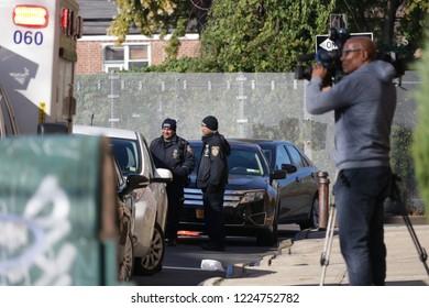 Elmhurst, NY / United States - November 8 2018: NYPD responds to a student stabbing at the Corona Civic Leadership Academy high school. News crew on scene.