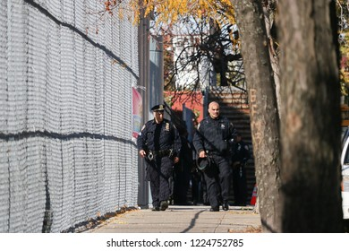 Elmhurst, NY / United States - November 8 2018: NYPD responds to a student stabbing at the Corona Civic Leadership Academy high school. Two police officers on scene after student removed to hospital.