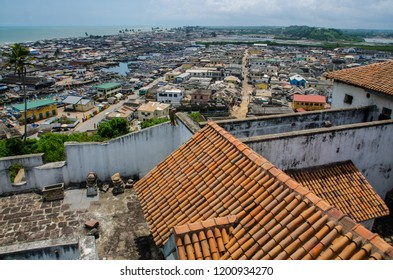 Elmina, Central Region / Ghana - September 25th 2018. Elmina and its rooftops and fishing boats, from St. George Fort.