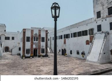 Elmina / Ghana - 03.14.2015: Street light in the courtyard of the old slave castle in Elmina.
