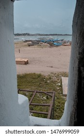 Elmina / Ghana - 03.22.2015: A view to the landscape (sandy beach and old wooden boats) surrounding the old Elmina slave castle in West Africa