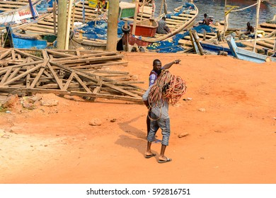 ELMINA, GHANA -JAN 18, 2017: Unidentified  Ghanaian man holds a skein of wire in Elmina. People of Ghana suffer of poverty due to the bad economy