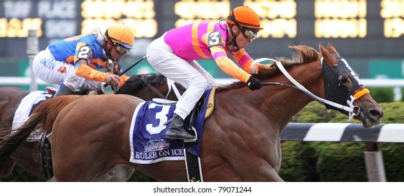 "ELMONT, NY - JUN 11: Jockey Jose Valdiva, Jr. pilots ""Ruler on Ice"" to victory in the 2011 Belmont Stakes at Belmont Park on Jun 11, 2011 in Elmont, NY."