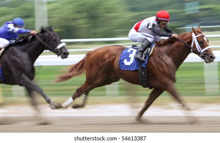 ELMONT, NY - JUN 5: Jockey Alan Garcia guides Trappe Shot to victory in an allowance race at Belmont Park on Jun 5, 2010 in Elmont, NY.