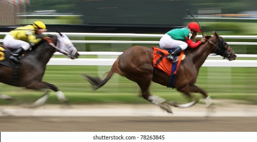 ELMONT, NY - MAY 29: Cornelio Velasquez and Full of Gut storm by Javier Castellano and Lady of the Forest to win a claiming race at Belmont Park on May 29, 2011 in Elmont, NY.